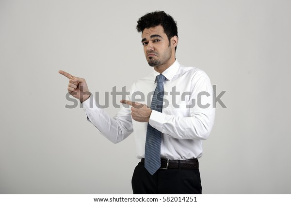 Employee pointing towards something with an unhappy expression