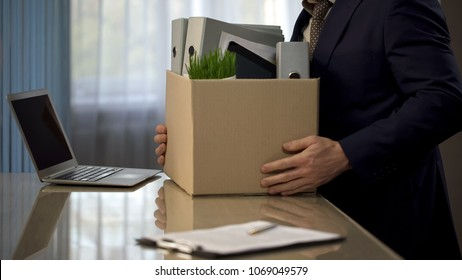 Employee putting his stuff from work desk in carton box, leaving job, retirement, stock footage