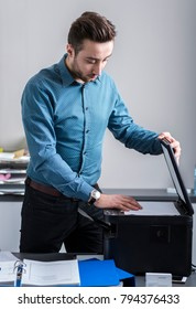 The employee supports multifunction machine - photocopying