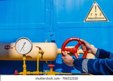 "An employee tightens the valve at gas metering station ""Uzhgorod"" near the Chaslivci village, not far from western Ukrainian city of Uzhgorod, Transcarpathian region on May 21, 2014."