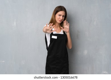 Employee woman nervous and scared stretching hands to the front