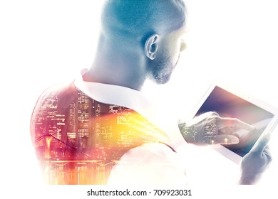 Employee working on a tablet pc double exposure rear view