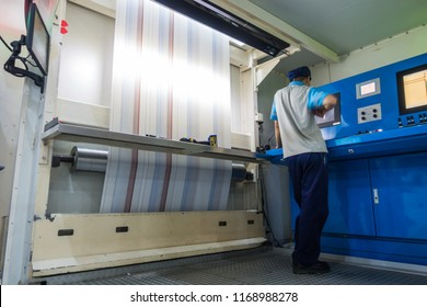 Employee Working at Printing Equipment Factory Industrial Setting