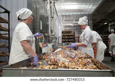 Employees Of The Bakery Prepare Billets From Dough For Baking Products At One