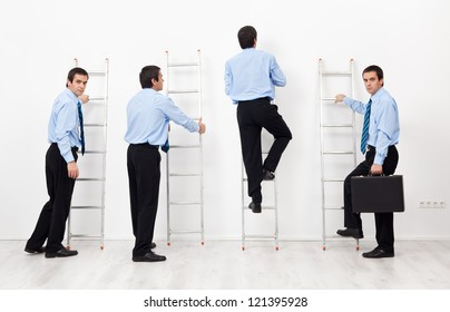 Employees climbing the corporate ladders competing with each other