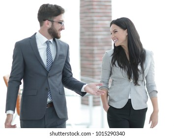 employees of the company discuss working issues standing in the office