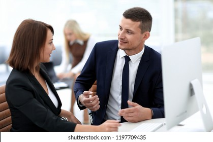 employees discussing business issues in office
