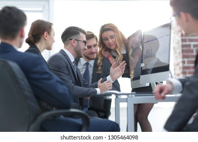 employees discussing financial charts