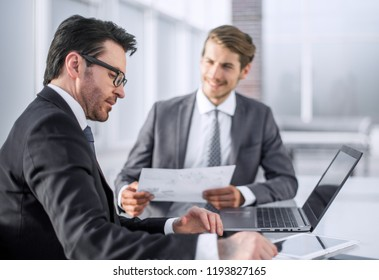 employees discussing financial data