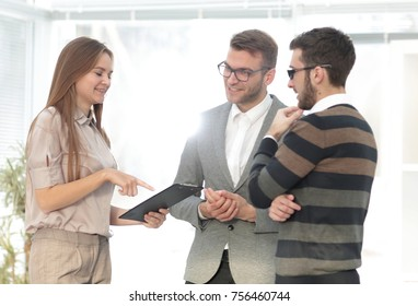 employees discussing working paper