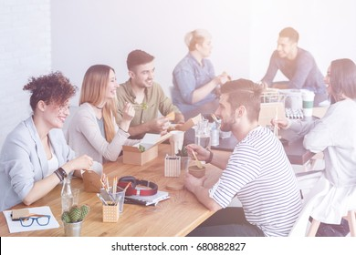 Employees enjoying their lunch and talking to each other