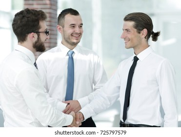 employees greet each other by shaking hands