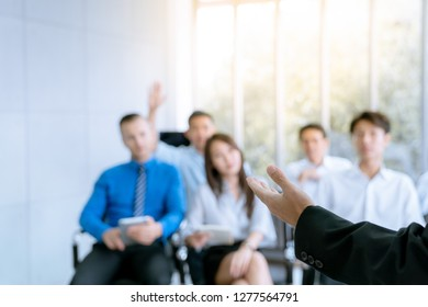 Employees are the questions ask during the meeting, the plan of the company , picture focus at hand of speaker
