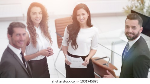 employees standing in a modern office