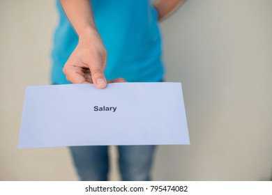 Employees wearing a blue shirt pay a salary.