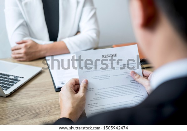 Employer arriving for a job interview, businessman listen to candidate answers explaining about his profile and colloquy dream job, manager sitting in job Interview talking in office.