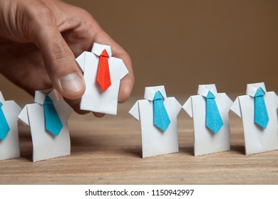 Employer chooses takes in hand employee. Leader stands out from crowd. Looking for good worker. HR, HRM, HRD concepts