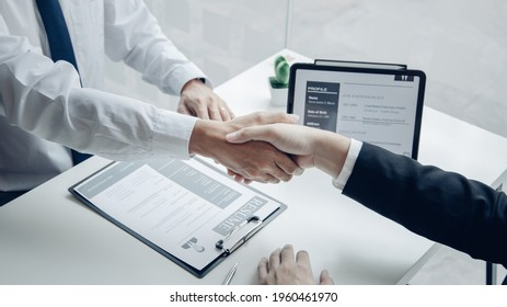 Employer or HR department welcomes new employees, Shaking hands with congratulations or achieving business and income success, selection of new staff representatives, Qualified, Hand shake concept.