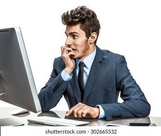 Employer looking at computer screen with horror / modern businessman at the workplace working with computer, depression and crisis concept