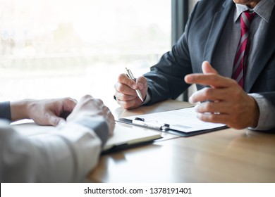 Employer or recruiter holding reading a resume during about colloquy his profile of candidate, employer in suit is conducting a job interview, manager resource employment and recruitment concept.