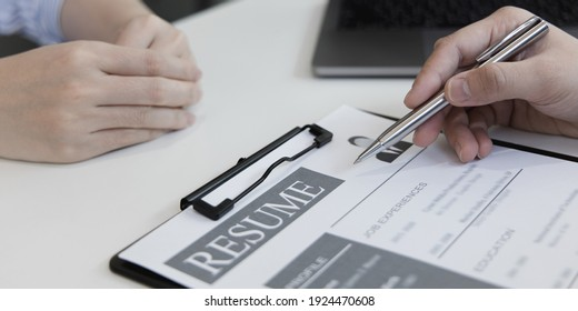Employer or selection committee is reading the candidate's resume and competence background, Job interview by HR, History exam and work ability, Employment and Recruitment Concept.