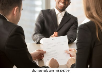 Employers or recruiters review cv of black confident job applicant smiling at background during employment interview, good resume template writing tips, hire me, starting building career, close up