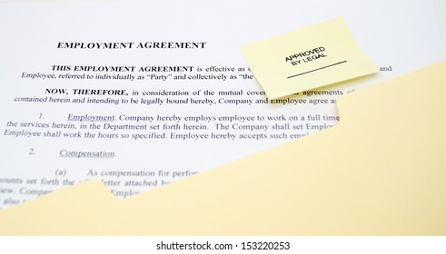 Employment agreement in manila file folder with Approved By Legal stamp.
