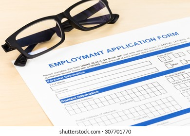 Employment application form with glasses concept job applying