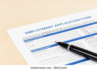 Employment application form with pen concept job applying