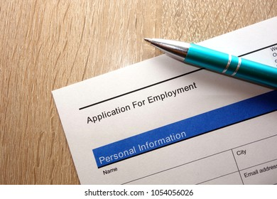 Employment application form and pen on desk, looking for a job concept