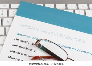 employment contract on the comuter keyboard