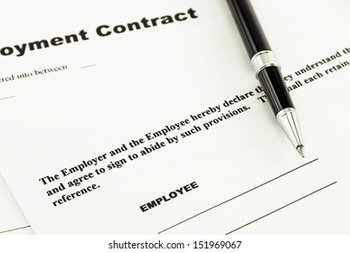 Employment contract and pen ready to sign it