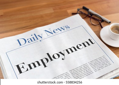Employment headlined newspaper on the table