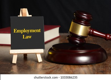 Employment Law sign with gavel and red book