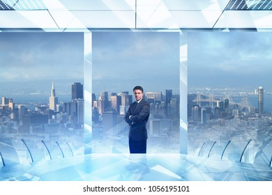 Employment and leadership concept. Thoughtful young european businessman standing in modern office interior with abstract city view and daylight. 3D Rendering
