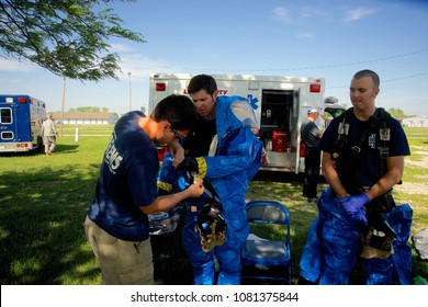 Emporia Kansas, USA, May 6, 2014 Members of the Emporia Kansas Fire Department get into level A protection suits as part of a CBRN (Chemical, Biological, Radiation, Nuclear) drill.