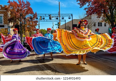 Emporia, Kansas, USA, October 27, 2018 Women dressed in traditional La Calavera Catrina costumes dance the Larabe Tapatio during the Day of the Dead (Dia de los Muertos) event held in downtown today