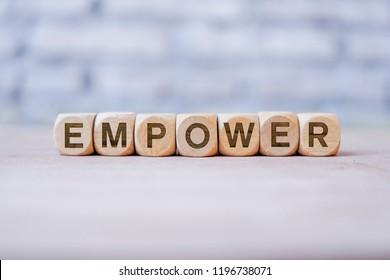 Empower word written on wood block