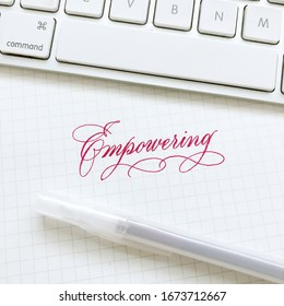 Empowering modern pink brush calligraphy in copperplate style.