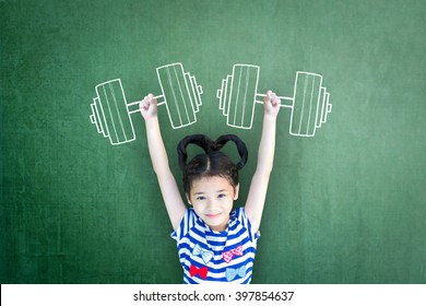 Empowering woman and girl gender rights concept for international day of girl child, and sports for development and peace with healthy strong kid with dumbbell exercise doodle on school chalkboard