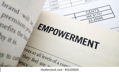Empowerment word on book. Business success concept.