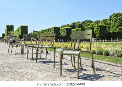 Empry chairs in the Jardin du Luxembourg, or the Luxembourg Garden, located in the 6th arrondissement of Paris, France.