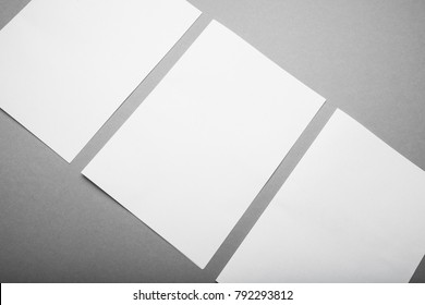 Empty A4 paper on a gray background, a place for design. Mock-up.