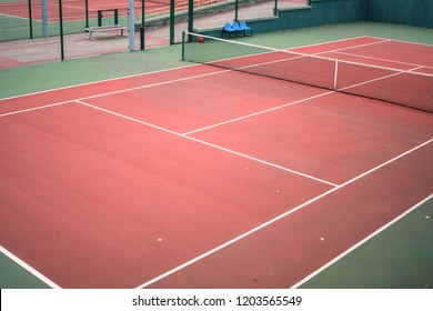 empty, abandoned hard tennis court