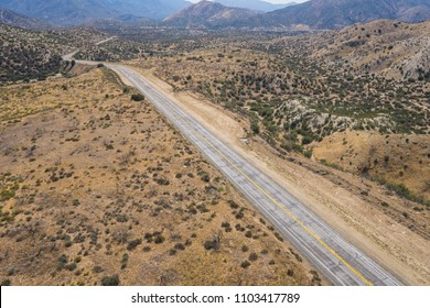 Empty abandoned road in the wilderness of the Mojave desert in the American southwest.