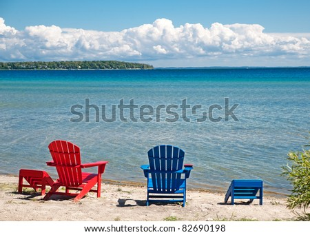 Adirondack chairs on beach Summer Lounge Empty Adirondack Chairs On The Beach Face The Blue And Turquoise Water And An Island In Shutterstock Empty Adirondack Chairs On Beach Face Stock Photo edit Now