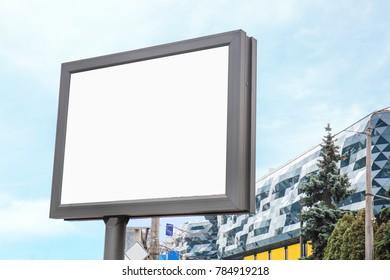 Empty advertising board on city street