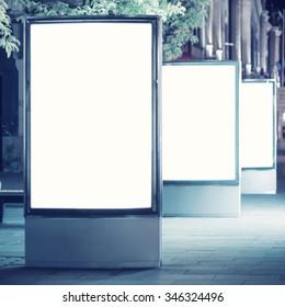 Empty advertising panels at night
