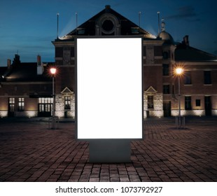 Empty advetising banner, billboard in the city at night with copy space and clipping path