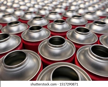 Empty aerosol cans in production factory awaiting filling with products